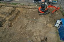 Aerial image of a digger at a construction site